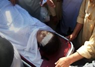 Pakistani hospital workers carry injured Malala Yousafzai, 14, on a stretcher following an attack by gunmen in Mingora. The children's rights activist was shot in the head in an assassination attempt as she boarded a school bus in the former Taliban stronghold of Swat, officials said