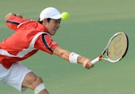 Kei Nishikori of Japan hits a return against Sam Querrey of the US during their second round match at the Shanghai Masters tennis tournament. Nishikori was dumped out of the Shanghai Masters by Querrey as defending champion Andy Murray was handed a walkover into the third round