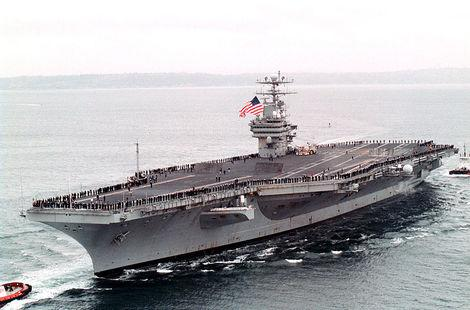 The historic USS Carl Vinson plays host to the 2011 Quicken Loans Carrier Classic, in which Michigan State takes on No. 1 North Carolina.