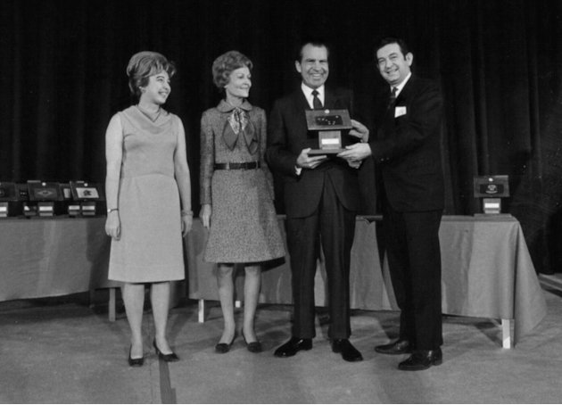 In this Dec. 3, 1969 photo provided by of the Richard Nixon Presidential Library, President Richard Nixon presents Moon rocks to then Governor of Alaska Keith Mille, right, as Pat Nixon, second left,