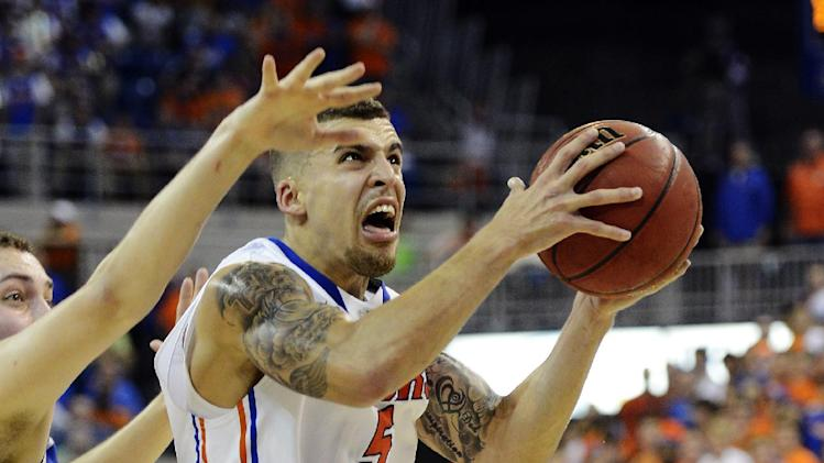 Florida guard Scottie Wilbekin (5) drives to the basket past Kentucky forward Kyle Wiltjer (33) during the second half of an NCAA college basketball game in Gainesville, Fla., Tuesday, Feb. 12, 2013. Florida won 69-52. (AP Photo/Phil Sandlin)