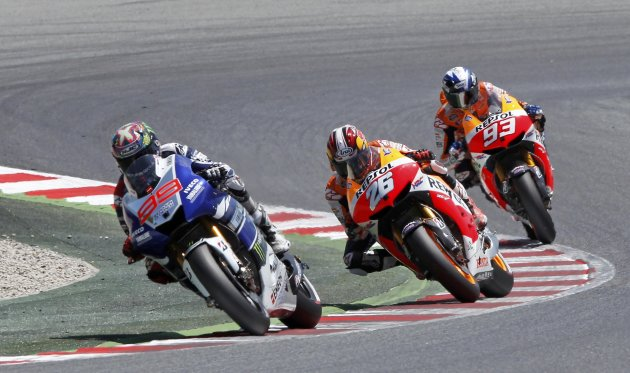 Yamaha MotoGP rider Lorenzo of Spain leads the race followed by compatriots Pedrosa and Marquez during the Catalunya Grand Prix