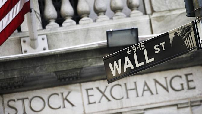 FILE - This July 16, 2013, file photo, shows a Wall Street street sign outside the New York Stock Exchange. Stocks are edging mostly higher, Wednesday, Feb. 10, 2016, setting the market up for its first gain after three down days. (AP Photo/Mark Lennihan, File)