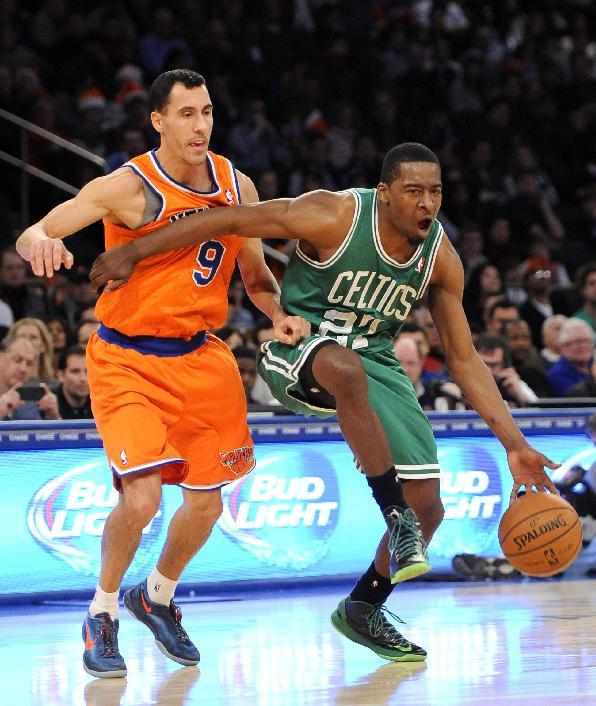 Boston Celtics' Jordan Crawford (27) drives the ball past New York Knicks' Pablo Prigioni (9) during the second half an NBA basketball game on Sunday, Dec. 8, 2013, in New York. The Celtics wo