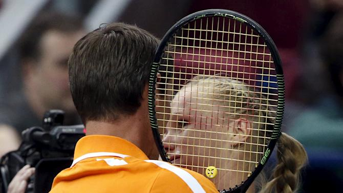 Kiki Bertens of the Netherlands is congratulated by captain Paul Haarhuis after defeating Russia's Svetlana Kuznetsova in their Fed Cup World Group tennis match in Moscow