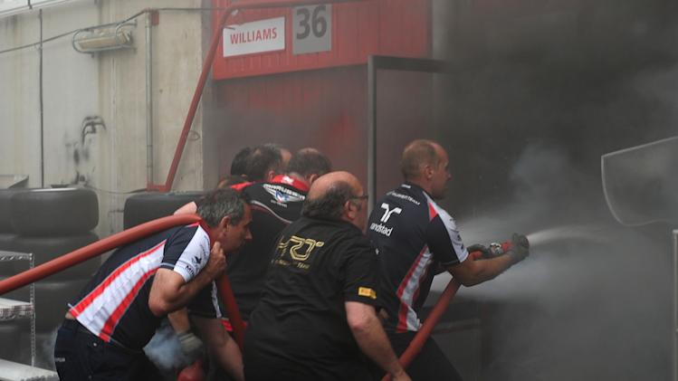 Racing team crews try to extinguish a fire in the Williams racing pit stand at the Circuit de Catalunya on May , 2012 in Montmelo on the outskirts of Barcelona after the Spanish Formula One Grand Prix.     AFP PHOTO / DIMITAR DILKOFFDIMITAR DILKOFF/AFP/GettyImages