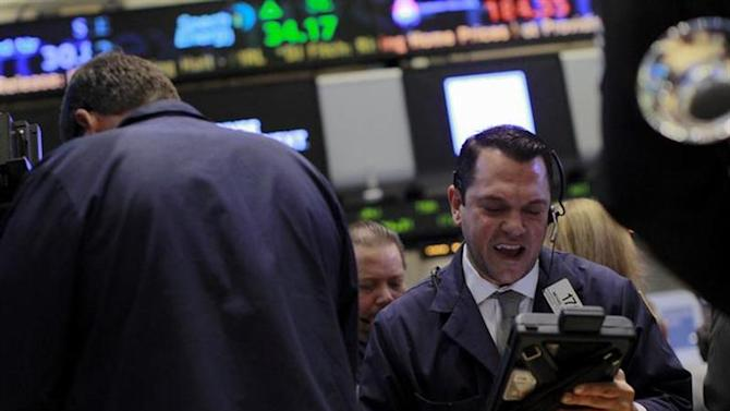 Traders work on the floor of the New York Stock Exchange, November 11, 2013.