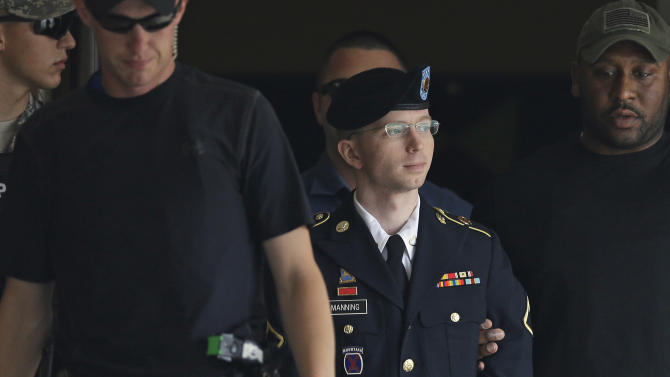 Army Pfc. Bradley Manning is escorted out of a courthouse in Fort Meade, Md., Tuesday, July 30, 2013, after receiving a verdict in his court martial. Manning was acquitted of aiding the enemy — the most serious charge he faced — but was convicted of espionage, theft and other charges, more than three years after he revealed secrets to WikiLeaks. (AP Photo/Patrick Semansky)