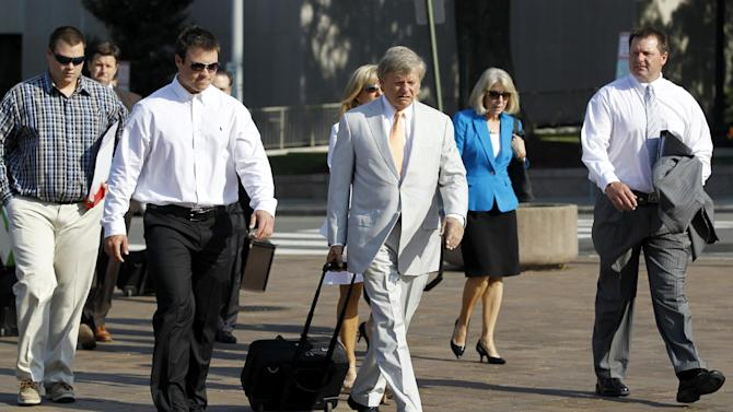 Former Major League Baseball pitcher Roger Clemens, right, accompanied by his attorney Rusty Hardin, center, arrives at federal court in Washington, Monday, June 11, 2012, for his perjury trial. (AP Photo/Haraz N. Ghanbari