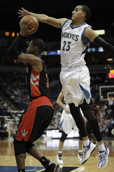 Minnesota Timberwolves guard Kevin Martin (23) tries to strip the ball from Toronto Raptors forward Terrence Ross in the first half of an NBA basketball game on Sunday, March 9, 2014, in Minneapolis