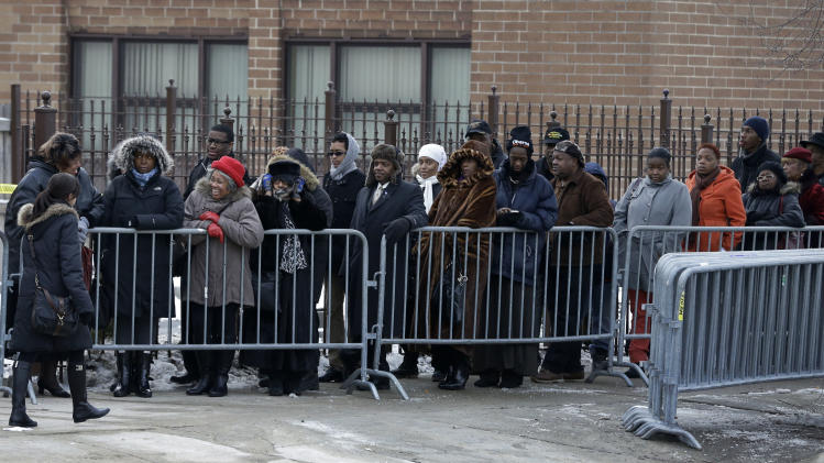 Mourners wait outside the Greater Harvest Missionary Baptist Church for the funeral service of Hadiya Pendleton Saturday, Feb. 9, 2013, in Chicago. The shooting death of the 15-year-old honor student has drawn attention to the staggering gun violence in the nation's third-largest city. (AP Photo/Nam Y. Huh)
