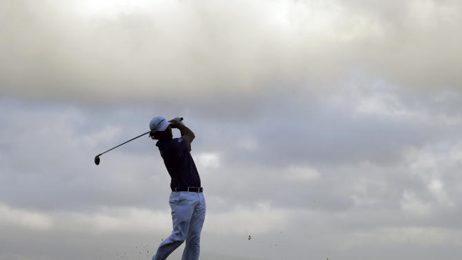 Scott Piercy tees off on the 10th hole during the first round at the Tournament of Champions PGA golf tournament Monday, Jan. 7, 2013 in Kapalua, Hawaii. Play was scheduled to begin three days earlier, but was delayed due to weather. (AP Photo/Elaine Thompson)