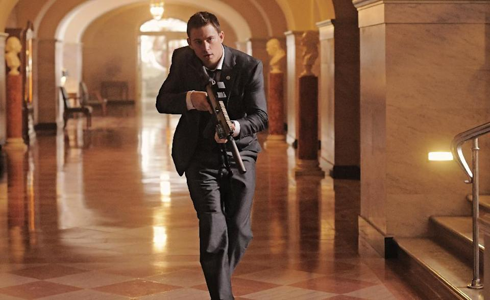 "This film publicity image released by Columbia Pictures shows Channing Tatum in a scene from ""White House Down."" (AP Photo/Sony Columbia Pictures, Reiner Bajo)"
