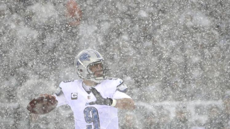 Detroit Lions' Matthew Stafford drops back to pass during the first half of an NFL football game against the Philadelphia Eagles, Sunday, Dec. 8, 2013, in Philadelphia. (AP Photo/Matt Rourke)