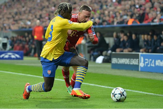 Bayern's Franck Ribery of France, right, and Arsenal's Bacary Sagna challenge for the ball during the Champions League round of the last 16 second leg soccer match between FC Bayern Munich and