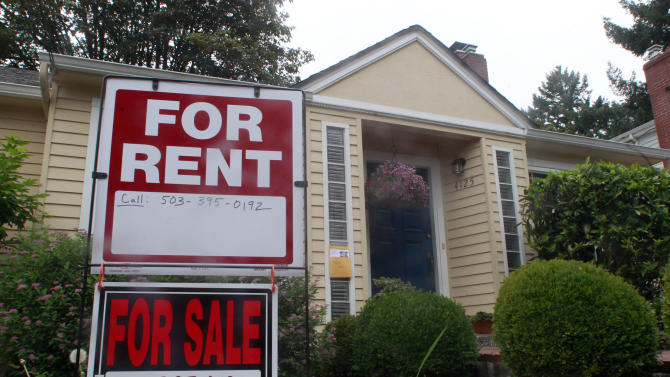 This Sept. 13, 2011, photo shows a house for rent and for sale sign in front of a home in Portland, Ore. The number of Americans who bought previously occupied homes rose in August. But sales were driven by an increase in foreclosures, evidence the housing market remains weak. (AP Photo/Rick Bowmer)