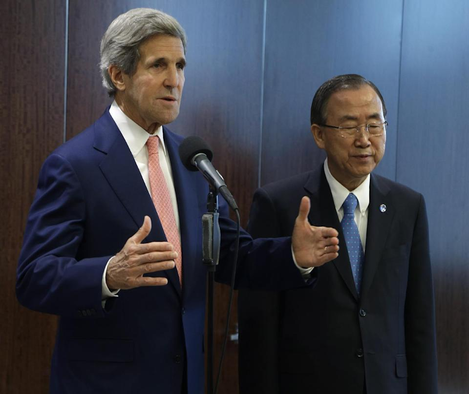 United States Secretary of State John Kerry, left, speaks while United Nations Secretary-General Ban Ki-moon listens before a meeting at United Nations Headquarters Thursday, July 25, 2013. (AP Photo/Seth Wenig)