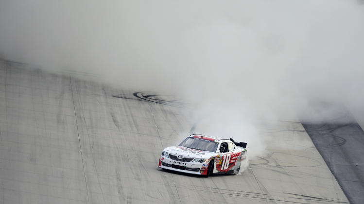 Joey Logano does a burnout after he won the NASCAR Nationwide Series auto race Saturday, Sept. 29, 2012, at Dover International Speedway in Dover, Del. (AP Photo/Nick Wass)