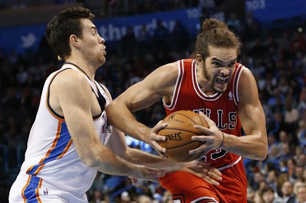 Chicago Bulls center Joakim Noah, right, drives past Oklahoma City Thunder forward Nick Collison during the first quarter of an NBA basketball game in Oklahoma City, Thursday, Dec. 19, 2013