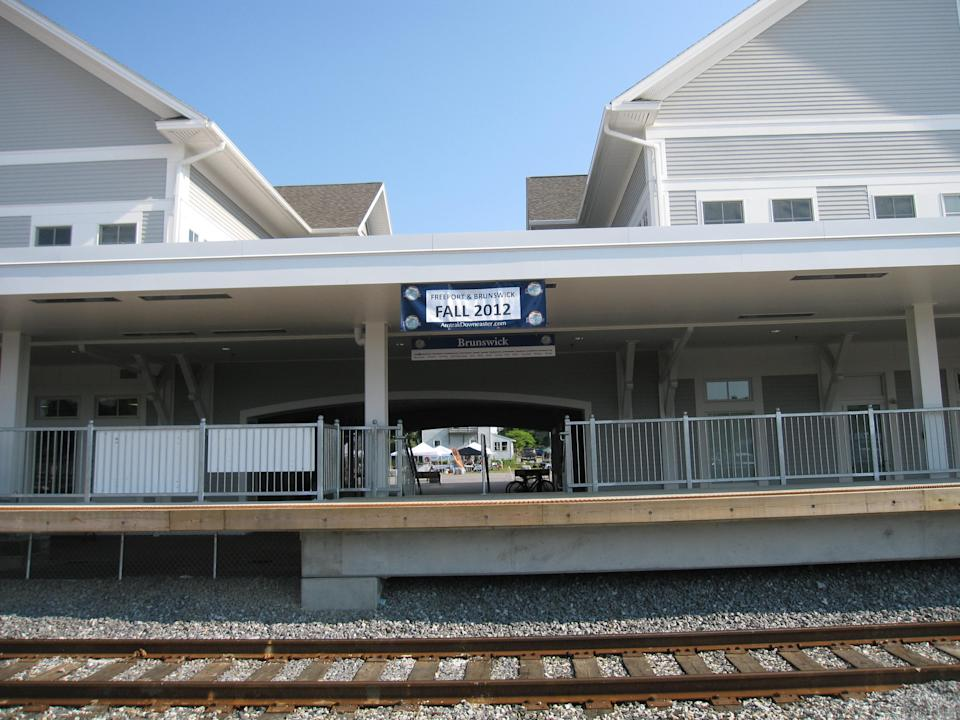 This July 13, 2012 photo shows the station and tracks in Brunswick, Maine, for Amtrak's Downeaster train, which will extend its route from Boston and Portland to Brunswick in November. It will be the first regularly scheduled passenger rail service for the town in more than 50 years. (AP Photo/Beth Harpaz)