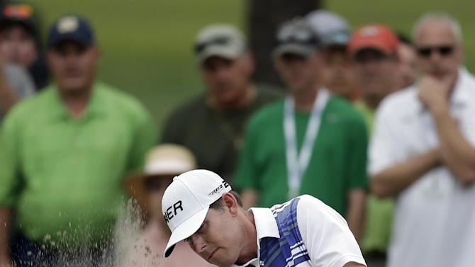 Justin Leonard hits from the sand trap on the 16th hole during the final round of the Tampa Bay Championship golf tournament  on Sunday, March 17, 2013, in Palm Harbor, Fla. (AP Photo/Chris O'Meara)