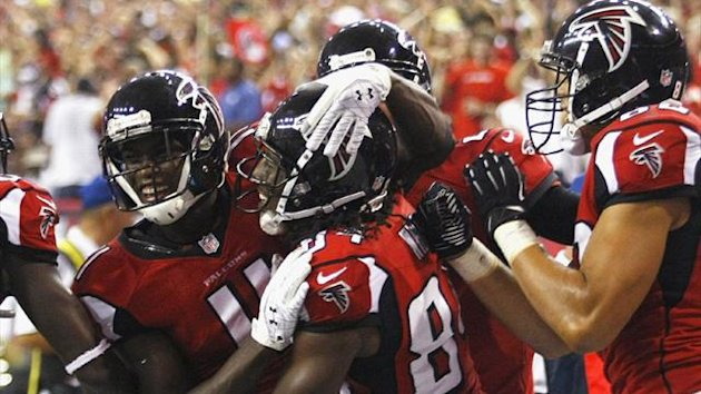 Atlanta Falcons wide receivers Julio Jones, Roddy White and tight end Tony Gonzalez celebrate White's touchdown pass against the Denver Broncos (Reuters)