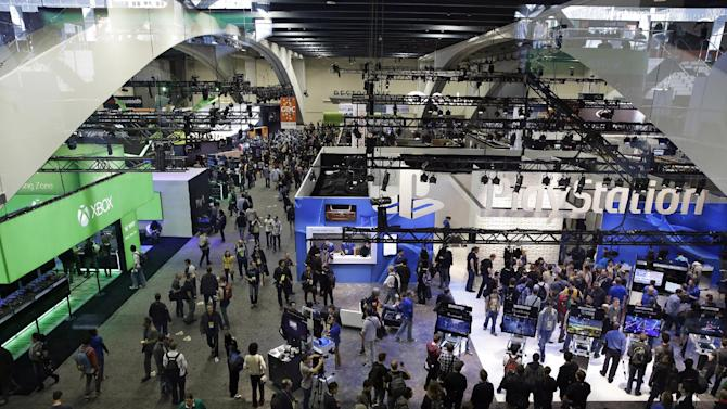 People walk through the exhibit hall at the Game Developers Conference, Wednesday, March 4, 2015, in San Francisco. (AP Photo/Eric Risberg)