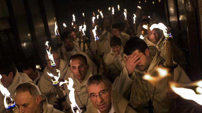 Penitents from 'Cristo de la Buena Muerte' or 'Good Dead Christ' brotherhood take part in a procession in Zamora, Spain, on the early hours of Tuesday, March 31, 2015. Hundreds of processions take place throughout Spain during the Easter Holy Week. (AP Photo/Andres Kudacki)