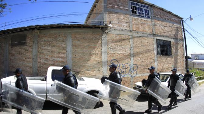 Federal police officers walk on the streets near the attorney general's office in Chilpancingo, in the Mexican state of Guerrero