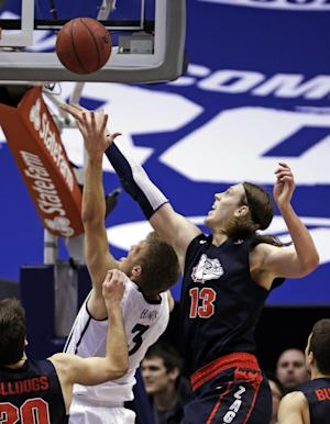 Brigham Young's Tyler Haws (3) shoots as Gonzaga's Kelly Olynyk (13) defends during the first half of an NCAA college basketball game, Thursday, Feb. 28, 2013, in Provo, Utah. (AP Photo/Rick Bowmer)