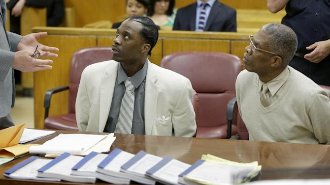 "Vincent George Sr., right, and Vincent George Jr. listen to a lawyer before the start of closing arguments in the the sex-trafficking case in New York, Thursday, June 6, 2013.  Prostitutes in the sex-trafficking case that's winding down,  say they and their pimps were one big happy family, enjoying a comfortable suburban life as ""wife-in-laws"" in Pennsylvania and commuting by night to work in Manhattan. Both men have pleaded not guilty to sex trafficking, money laundering and other charges.  (AP Photo/Seth Wenig)"
