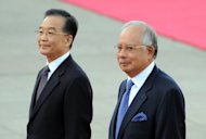 This file photo shows Chinese Premier Wen Jiabao (L) and his Malaysian counterpart Najib Razak during a ceremony in Beijing, in 2009. China will loan two endangered baby pandas to Malaysia for 10 years to commemorate strong diplomatic ties between the two Asian countries, the environment ministry said on Tuesday