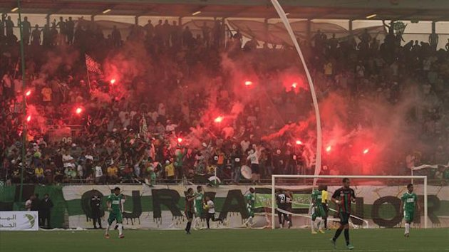 Fans of Libya's Al Nassr light flares after their team scored a goal against Morocco's FAR Rabat during their African Confederation Cup football match in Benghazi April 5, 2013 (Reuters)