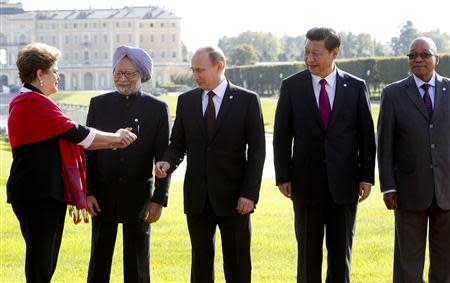 Brazil's President Rousseff gestures next to India's Prime Minister Singh, Russia's President Putin, China's President Xi and South African President Zuma as they pose for a picture after a BRICS leaders' meeting at the G20 Summit in Strelna