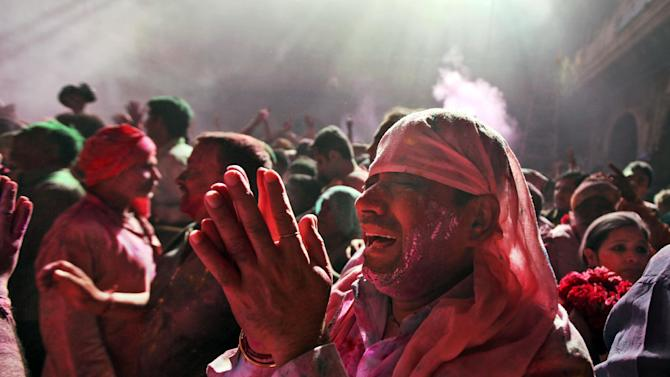 A Hindu devotee prays inside the Banke Bihari temple during holi celebrations in Vrindavan, India, Wednesday, March 27, 2013. Holi, the Hindu festival of colors that also marks the advent of spring, is being celebrated across the country Wednesday. (AP Photo/Altaf Qadri)