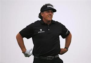 Mickelson watches his tee on the third hole during Abu Dhabi Golf championship