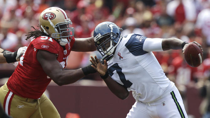 San Francisco 49ers defensive tackle Ray McDonald (91) sacks Seattle Seahawks quarterback Tarvaris Jackson (7) in the first quarter of an NFL football game in San Francisco, Sunday, Sept. 11, 2011. (AP Photo/Marcio Jose Sanchez)