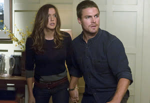 Katie Cassidy and Stephen Amell | Photo Credits: Jack Rowand/The CW.