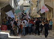"Syrians march in Aleppo during a protest against the regime of Syrian President Bashar al-Assad. The United States has denounced Russia's policy of aiding the Syrian regime as ""morally bankrupt,"" as tensions between Damascus and Ankara escalate over cargo seized from a Syrian passenger plane"