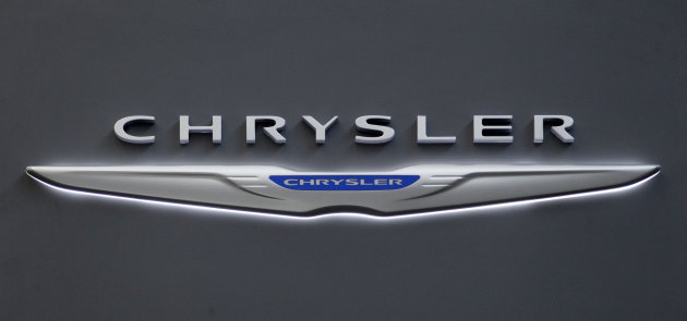 FILE - This Feb. 16, 2012 photo shows Chrysler logo on the Chrysler exhibit at the 2012 Pittsburgh Auto Show. Chrysler says its U.S. sales rose 13 percent in July on strong demand for the Chrysler 200 sedan and other models. Chrysler says it sold more than 126,000 new cars and trucks last month, the company&#39;s best July in five years. Sales of its best-selling Ram pickup rose 17 percent as home building increased. Sales of the 200 rose 43 percent. The company&#39;s sales increase was slightly above expectations for overall industry growth of about 11 percent. Car companies report U.S. sales throughout the day on Wednesday.(AP Photo/Gene J. Puskar)