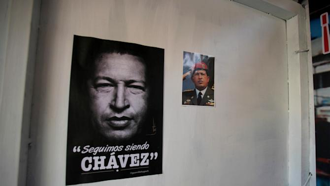 "Images of late Venezuela's President Hugo Chavez decorate a people's shrine built in his honor at the ""23 de Enero"" or ""23rd of January"" slum in Caracas, Venezuela, Wednesday, April 3, 2013. The shrine, named  ""Saint Hugo Chavez del 23"", has been visited by tens of thousands of Venezuelans to pay homage to a president for some, a saint for others. The poster read in Spanish: ""We Continue to be Chavez"". (AP Photo/Fernando Llano)"
