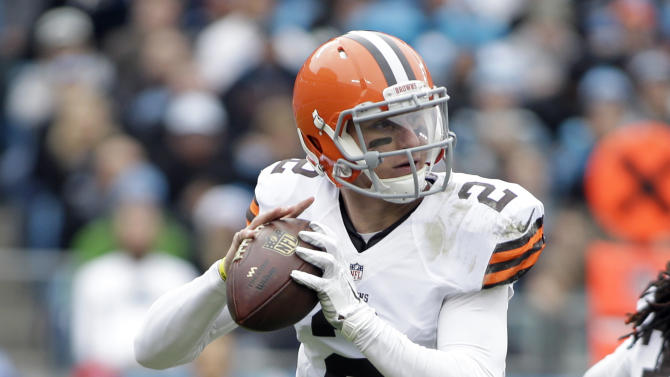 Cleveland Browns' Johnny Manziel (2) rolls out to pass against the Carolina Panthers in the first half of an NFL football game in Charlotte, N.C., Sunday, Dec. 21, 2014. (AP Photo/Bob Leverone)