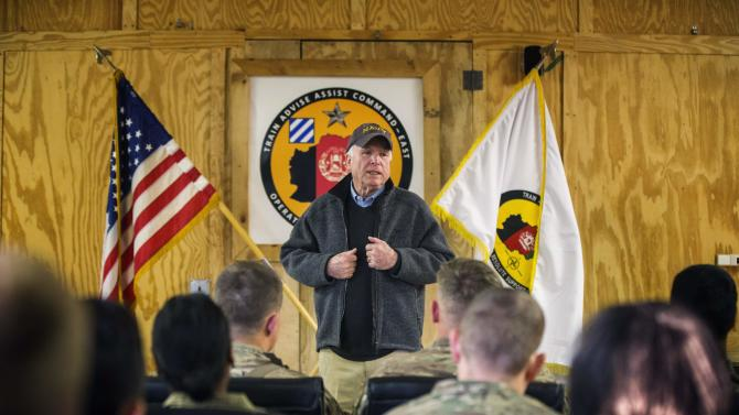 U.S. Senator John McCain speaks to soldiers during a Christmas day visit on forward operating base Gamberi in the Laghman province of Afghanistan