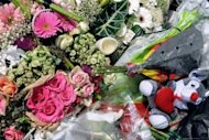 "Flowers are left outside the ""Ozar Hatorah"" Jewish school in Toulouse, where four people were killed by Islamic extremist Mohamed Merah. French authorities have rejected charges that intelligence failures allowed Merah to kill seven people, insisting there was no evidence he was anything but a lone wolf with no ties to Al-Qaeda"
