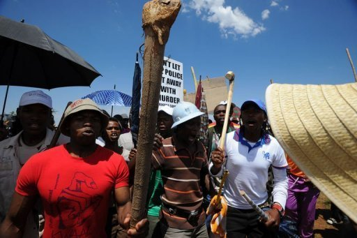 <p>Striking miners stage a protest on the hill at the AngloGold Ashanti mine in Carletonville, 84 kms northwest of Johannesburg. The head of South Africa's largest trade union grouping on Friday urged 24,000 striking AngloGold Ashanti miners to return to work.</p>