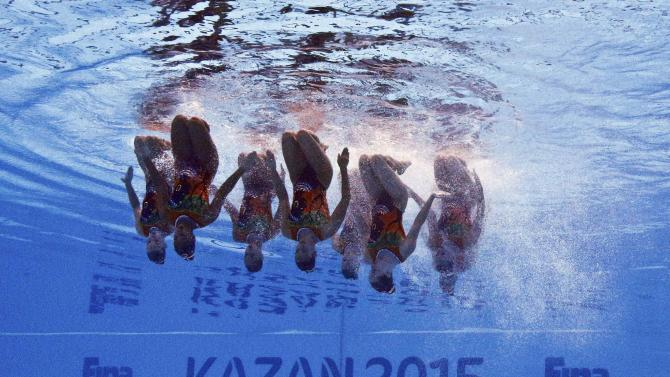 Members of Team Switzerland are seen underwater as they perform in the synchronised swimming team free routine preliminary at the Aquatics World Championships in Kazan