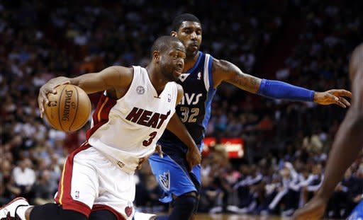 James scores 32, Heat beat Mavs in OT, 119-109