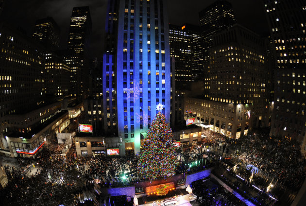 The Rockefeller Christmas tree, a 12-ton, 74-foot Norway spruce covered in 30,000 energy efficient LED lights, is lit in Rockefeller Center in New York, Tuesday, Nov. 30, 2010.