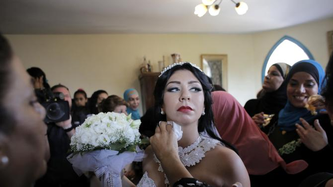 Bride Maral Malka, 23, celebrates with friends and family before her wedding to groom Mahmoud Mansour, 26, in Jaffa, south of Tel Aviv