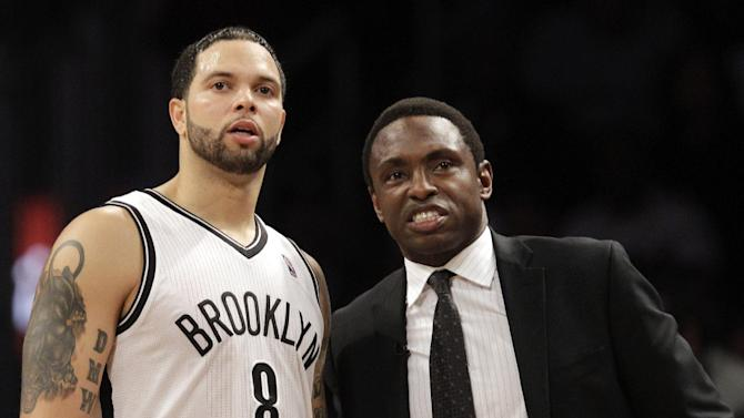 FILE - In this Dec. 11, 2012, file photo, Brooklyn Nets guard Deron Williams (8) and  head coach Avery Johnson chat during the second half of an NBA basketball game against the New York Knicks at the Barclays Center in New York. Johnson was fired on Thursday, Dec. 27, 2012, general manager Billy King announced. (AP Photo/Kathy Willens, File)